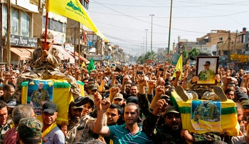 Supporters of Lebanon's Shi'ite Hezbollah movement carry the coffins of fighters killed in the assault on militants in the Jurud Arsal border region on the Lebanon-Syria border, July 31, 2017.