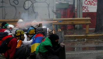 Demonstrators clash with riot security forces while rallying against Venezuela's President Nicolas Maduro's government in Caracas, Venezuela, July 28, 2017.