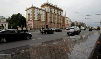 Cars drive past the U.S. embassy building in Moscow, Russia, July 28, 2017.
