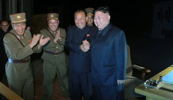 North Korean leader Kim Jong Un guides the second test-fire of intercontinental ballistic missile Hwasong-14 in this undated picture provided by KCNA in Pyongyang on July 29, 2017.