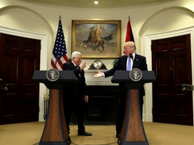 President Donald Trump reaches to shakes hands with Palestinian leader Mahmoud Abbas at the White House in Washington, Wednesday, May 3, 2017