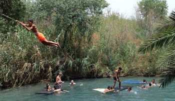 Israelis cool off at the Valley of Springs near Beit She'an, July 11, 2017.