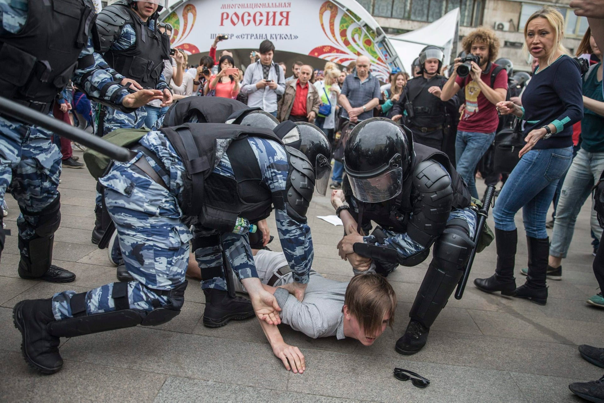 Police detain a protester In Moscow, Russia, June 12, 2017 during an anti-government demonstration called by Alexei Navalny, the the Kremlin's most visible opponent.