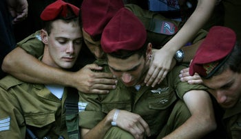 Israeli soldiers mourn during the funeral of Israeli army Staff Sgt. Michael Levin, August 3, 2006.