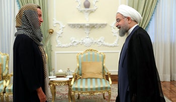 A handout picture provided by the office of Iranian President Hassan Rouhani on August 5, 2017, shows him meeting EU foreign affairs chief Federica Mogherini in Tehran.