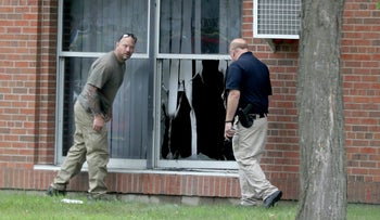 Law enforcement officials investigate an explosion at the Dar Al-Farooq Islamic Center in Bloomington, Minn., on Aug. 5, 2017.