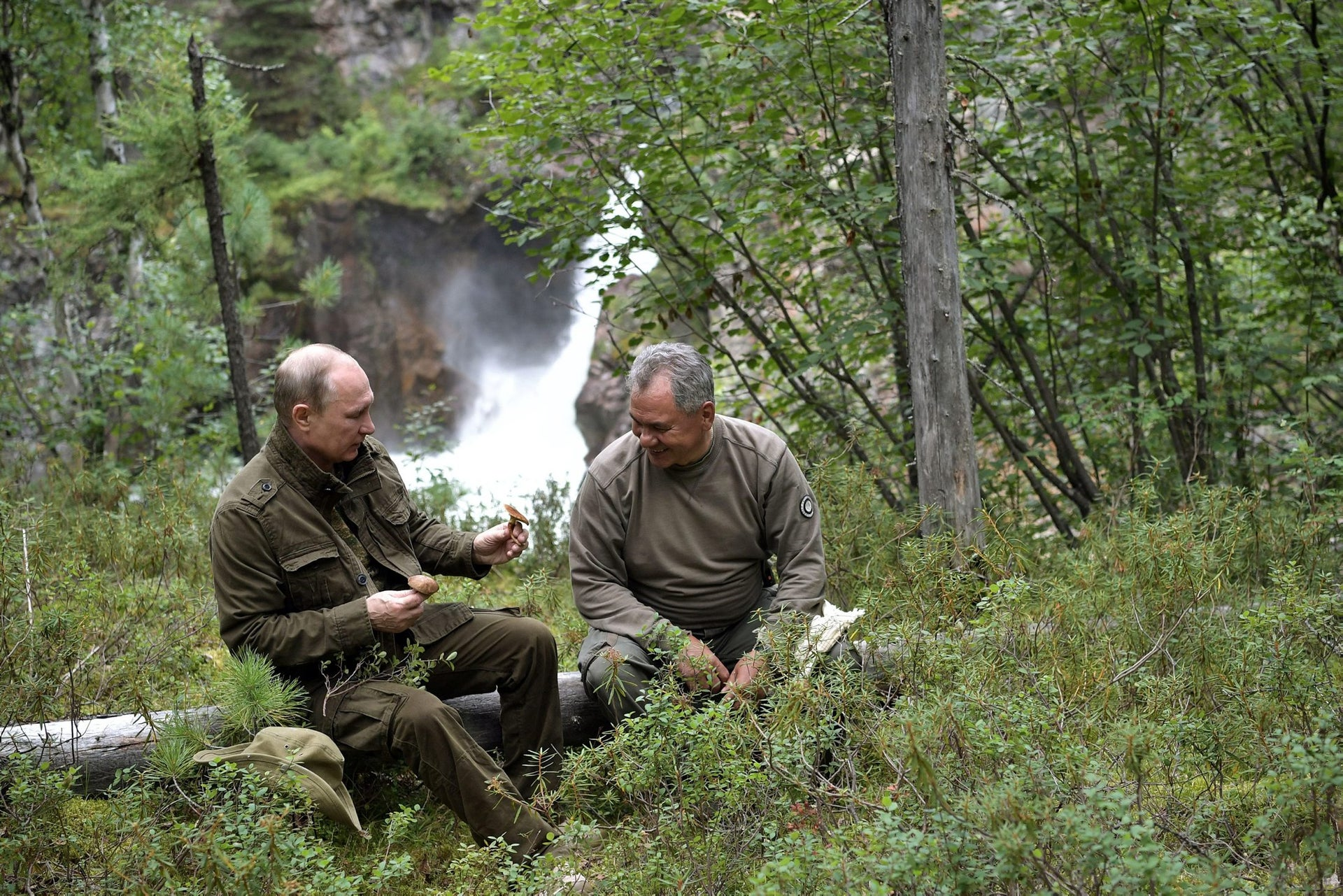 Russian President Vladimir Putin and Defense Minister Sergei Shoigu on a fishing trip which took place on August 1-3 in southern Siberia, Russia, in a photo released by the Kremlin on August 5, 2017.
