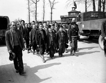 This April 1945 file photo shows children and other prisoners liberated by the 3rd U.S. Army marching from the Buchenwald concentration camp near Weimar, Germany.