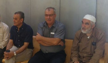 Israeli Arab leaders Sheikh Raed Salah, Mohammad Barakeh, and Jamal Zahalka(from right to left) await the court decision