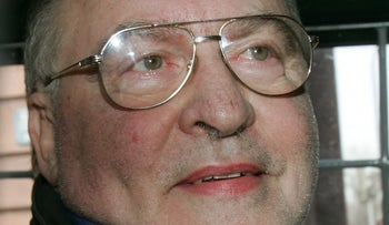 Ernst Zündel sits in a police car on his way out of the courthouse in Mannheim, southwestern Germany, Wednesday, March 2, 2005.