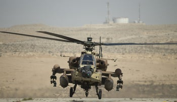 File photo: An Israeli AH-64 Apache helicopter lands at the Ramon air force base in the Negev Desert, southern Israel, on October 21, 2013.