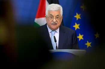 FILE - In this March 27, 2017, file photo, Palestinian President Mahmoud Abbas speaks during a new conference at EU headquarters in Brussels. President Donald Trump will press Abbas to end payments to families of Palestinians imprisoned in Israeli jails, according to U.S. officials, one of several actions Washington believes could lead to resumed peace talks with Israel. Other actions include a Palestinian end to anti-Israel rhetoric and incitement of violence, said officials familiar with planning for the meeting. It will be Trump and Abbasג€™ first face-to-face discussion. (AP Photo/Virginia Mayo, File)