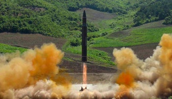 A test launch of a Hwasong-14 intercontinental ballistic missile in North Korea's northwest, July 4, 2017.