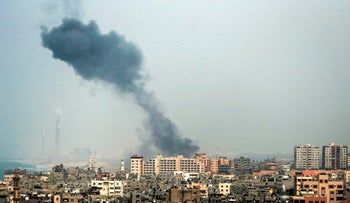 A smoke plume rises in Gaza City after a reported Israeli airstrike on March 18, 2017 in return for rocket fire from the strip.