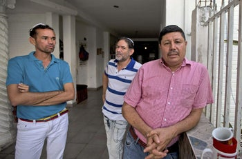 Venezuelan Jewish converts Hermidez Garcia, from right to left, Franklin Perez and Jackson Marrone in their home in Maracay, Venezuela, Jan. 31, 2017.