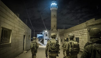 IDF soldiers during a nighttime raid in the West Bank (illustrative).