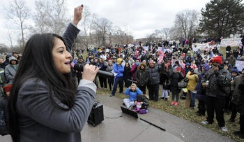 Adriana Alvarez, 28, of Detroit, fires up the crowd on 'A Day Without Immigrants,' February 16, 2017.