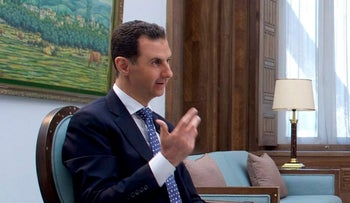 Syrian President Bashar Assad speaks during an interview with Hong-Kong based Phoenix TV in Damascus, Syria, March 11, 2017.