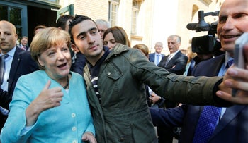 A Syrian refugee takes a selfie with German Chancellor Angela Merkel in Berlin, September 2015.