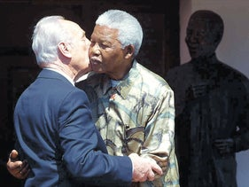 Shimon Peres and Nelson Mandela,  after a meeting at Mandela's house in Houghton, Johannesburg, Tuesday Sept. 3, 2002.