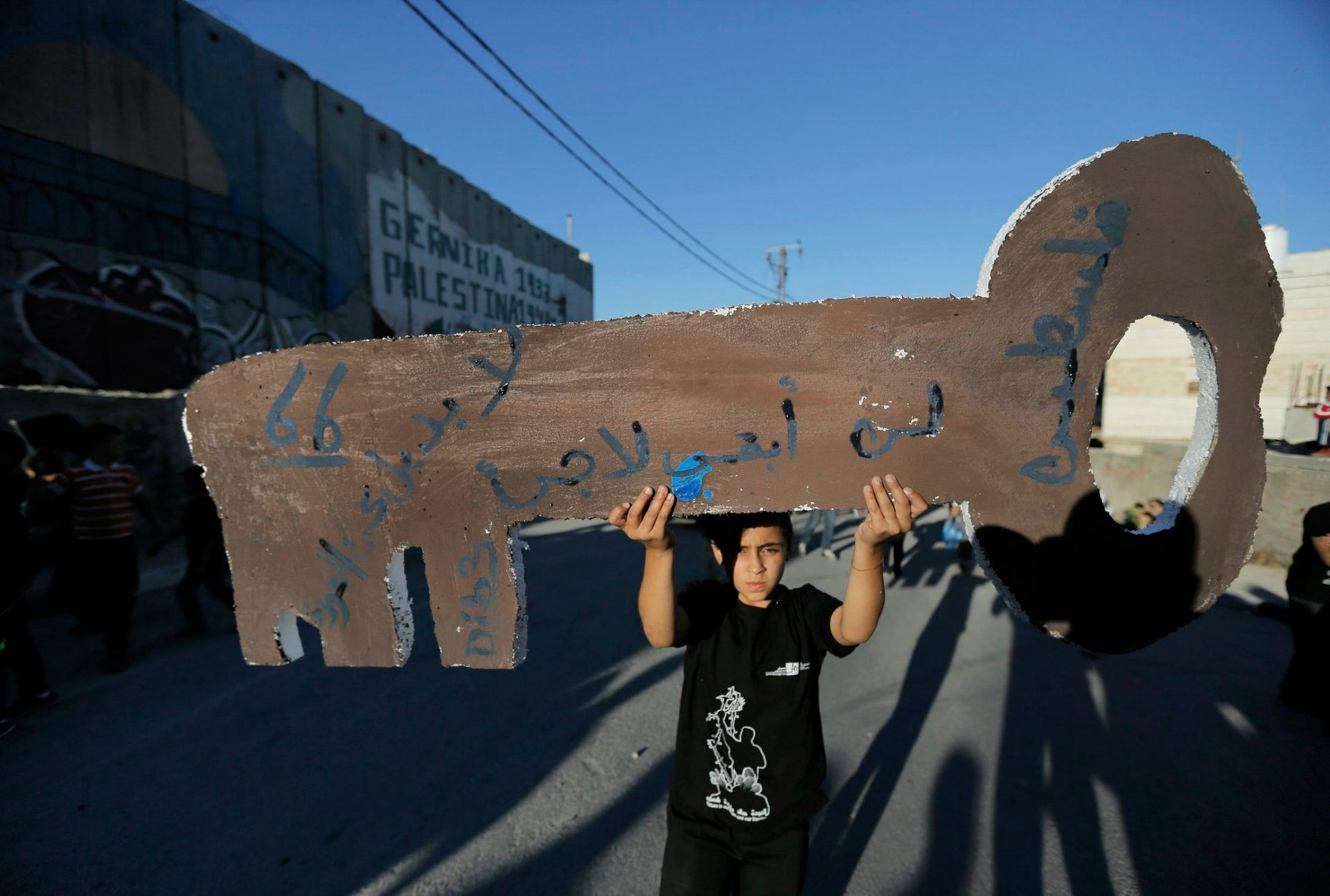 A boy holds a key in Bethlehem to mark the Nakba, on May 14, 2014.