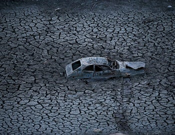 A car lies in the cracked earth of what had been the bottom of the Almaden Reservoir, San Jose, California. January 28, 2014.
