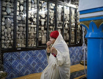 A Tunisian Jewish woman prays in La Ghriba, the synagogue in Djerba, southern Tunisia,Oct. 28, 2015.