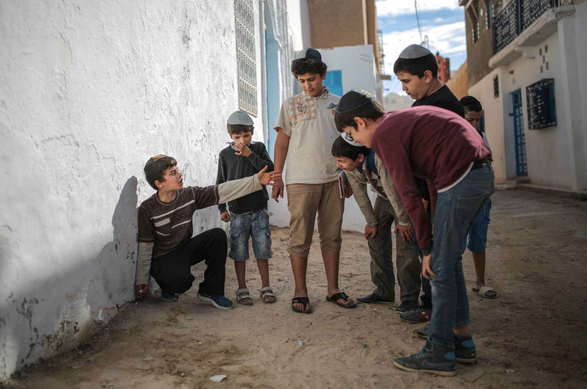 Boys play with marbles outside their school at Hara Kbira, the main Jewish neighborhood in the Island of Djerba, southern Tunisia,Oct. 30, 2015.