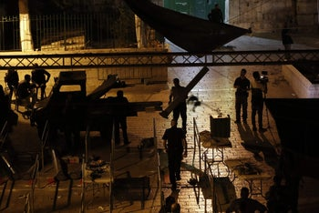 Israeli security forces take down security barriers at the Lions Gate, a main entrance to the Temple Mount in Jerusalem's Old City, on July 24, 2017.
