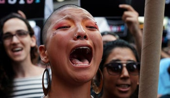 A participant cries during a protest against U.S. President Donald Trump's announcement that he plans to reinstate a ban on transgender individuals from serving in any capacity in the U.S. military, in Times Square, in New York City, New York, U.S., July 26, 2017.