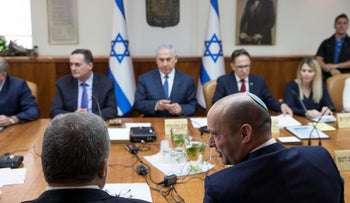 Israeli Minister of Education Naftali Bennett (R) speaks with Defense Minister Avigdor Lieberman during the weekly cabinet meeting in Jerusalem July 23, 2017.
