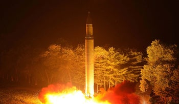 This Friday, July 28, 2017, photo distributed by the North Korean government shows what was said to be the launch of a Hwasong-14 intercontinental ballistic missile at an undisclosed location.