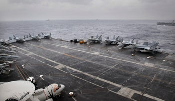 F18 aircrafts are parked on U.S. Navy aircraft carrier USS NIMITZ during the Malabar 2017 tri-lateral exercises between India, Japan and US in the Bay of Bengal, July 17, 2017.