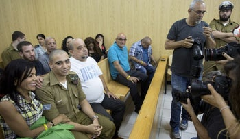 Sgt. Elor Azaria and his parents at a military court in Tel Aviv, July 2017.