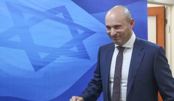Naftali Bennett, education minister and head of the national-religious Habayit Hayehudi party, walks into the weekly cabinet meeting.