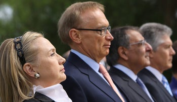 Hillary Clinton, then-U.S. secretary of state, next to Bob Carr, then-minister of foreign affairs, observe a moment of silence during a wreath-laying ceremony in Perth, Australia, on November 14, 2012.