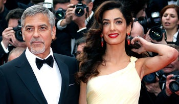 George Clooney and his wife Amal pose on the red carpet during the 69th Cannes Film Festival in France, May 12, 2016.