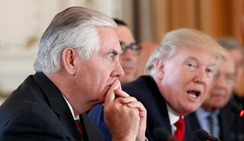 Secretary of State Rex Tillerson listens as President Donald Trump speaks during a bilateral meeting with Chinese President Xi Jinping at Mar-a-Lago in Palm Beach, Florida on April 7, 2017.