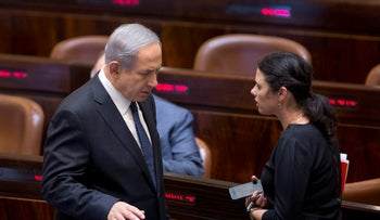 Prime Minister Benjamin Netanyahu and Justice Minister Ayelet Shaked in Israel's Knesset. Shaked says Netanyahu may not have to quit if he's indicted