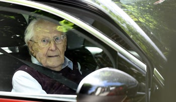 Convicted former SS officer Oskar Groening leaving after the verdict in his trial on July 15, 2015 at court in Lueneburg, northern Germany.