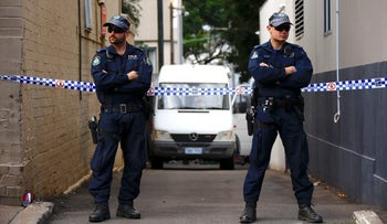 FILE PHOTO - Police officers block a small alley after Australian counter-terrorism police arrested four people in raids late on Saturday across several Sydney, July 30, 2017.