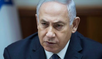 Prime Minister Benjamin Netanyahu attends the weekly cabinet meeting at his office in Jerusalem July 23, 2017.