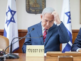 All Netanyahu's scandals, and where they stand. Pictured: The Prime Minister at a weekly cabinet meeting