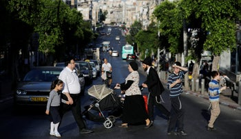Ultra-Orthodox people crossing the street in Bnei Brak, July 18, 2017.