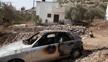 Archive - A torched car outside of Ramallah.