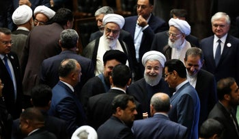 Iran's President Hasan Rohani, center, leaves the parliament at the end of his swearing-in ceremony for the second term in office, in Tehran, Iran, Saturday, Aug. 5, 2017.