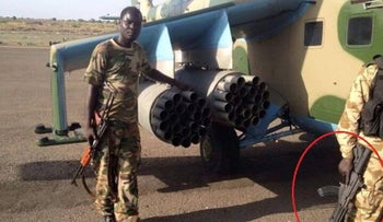An Israeli-made Galil ACE rifle, right, being held by a fighter in South Sudan.