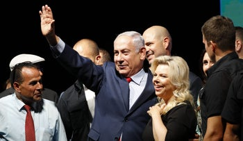 Benjamin Netanyahu and his wife Sara at a Likud rally in Tel Aviv on August 9, 2017 in a mass show of support for the PM who is facing a string of corruption investigations.