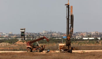 Cranes work on the Israeli side of the border with Gaza, July 23, 2017.