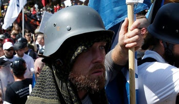 A white supremacist wearing a World War II German helmet arrives at a rally in Charlottesville, Virginia, U.S., August 12, 2017.
